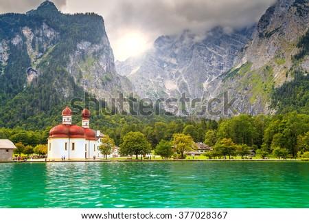 Beautiful fabulous alpine glacier lake Konigsee with stunning St Bartholoma church,Berchtesgaden,Bavaria,Germany,Europe - stock photo