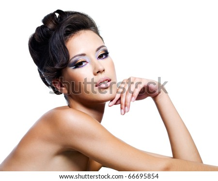 Beautiful face of a sexy woman with curly hairstyle and fashion makeup - stock photo