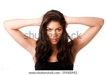 Beautiful face of mad woman expressing stressed holding head with long brown hair, isolated. - stock photo