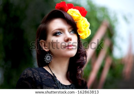 Beautiful face of woman in vintage style - stock photo