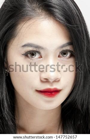 Beautiful face of young asian woman - stock photo