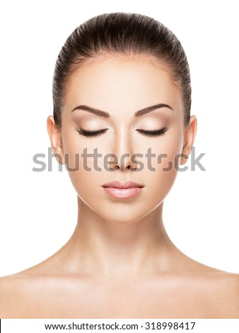Beautiful face of young caucasian woman with health fresh skin  - isolated on white.  Closed eyes - stock photo