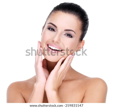 Beautiful face of young smiling woman with clean fresh skin - isolated on white - stock photo