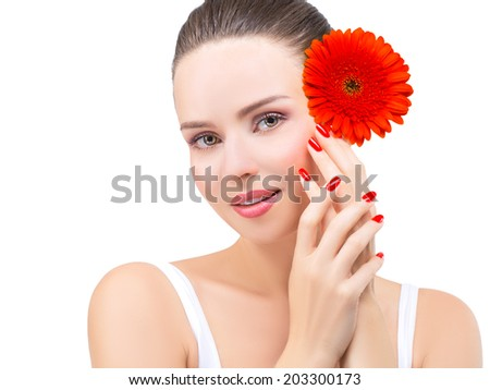 Beautiful Face of Young Woman with Clean Fresh Skin, close up isolated on white. Beautiful Spa Woman Smiling. Perfect Fresh Skin. Red manicure, with hands. Body and Skin Care Concept - stock photo