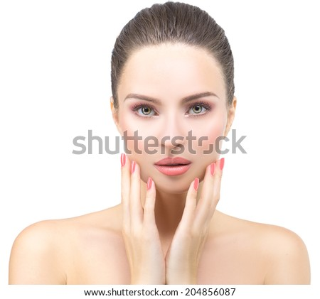 Beautiful Face of Young Woman with Clean Fresh Skin close up isolated on white. Beauty Face Portrait. Beautiful Spa Woman. Day make up and manicure. Perfect Fresh Skin. Youth and Skin Care Concept - stock photo
