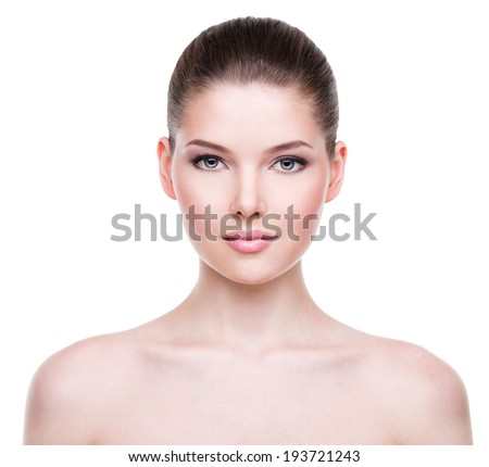 Beautiful face of young woman with clean fresh skin - isolated on white. - stock photo