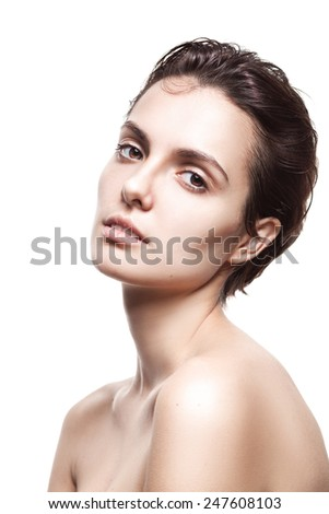 Beautiful face of young  woman with clean fresh skin isolated over white - stock photo