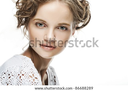 Beautiful face of young woman with curly hair - stock photo