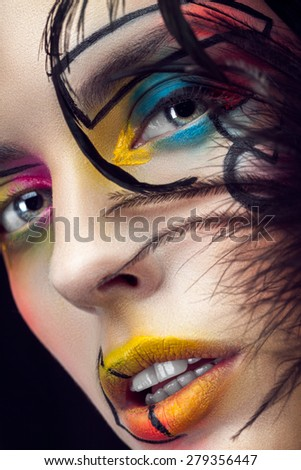 Beautiful face with feathers closeup - stock photo