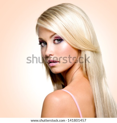 Beautiful face with satured colors of make-up and straight long hair - stock photo