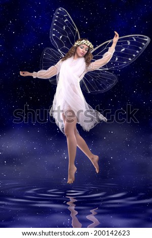 Beautiful fairy dancing above water - stock photo