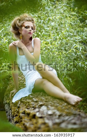 Beautiful fairy girl in a forest - stock photo