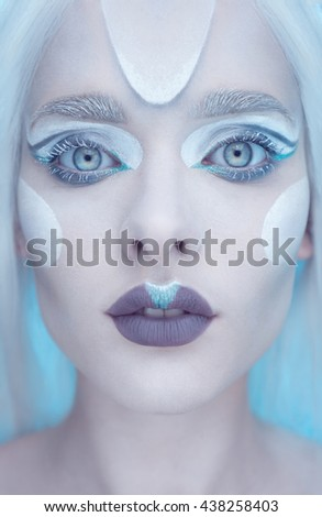 Beautiful fairy winter queen with frosted makeup  - stock photo