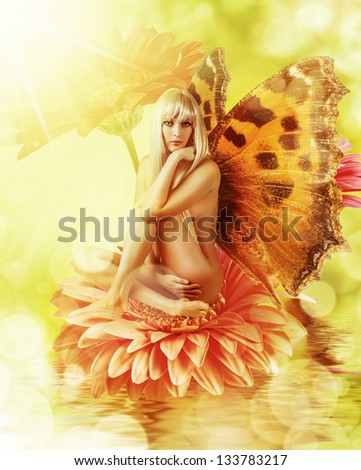 Beautiful fairy with wings on a flower in water. Sexy blonde nude butterfly woman - stock photo