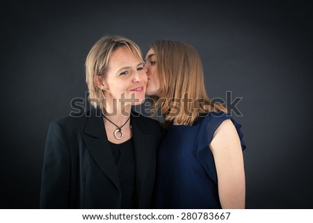 Beautiful family doing different expressions in different sets of clothes: kiss - stock photo