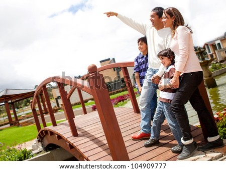Beautiful family enjoying outdoors looking very happy - stock photo