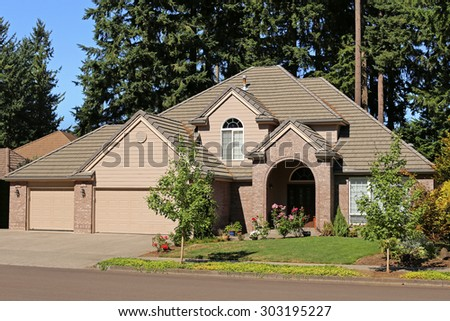 Beautiful Family Home in Suburban Neighborhood - stock photo