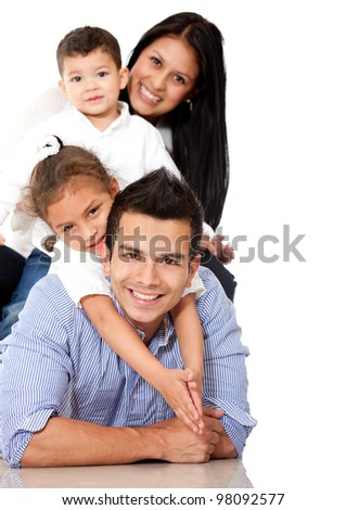 Beautiful family lying down - isolated over a white background - stock photo