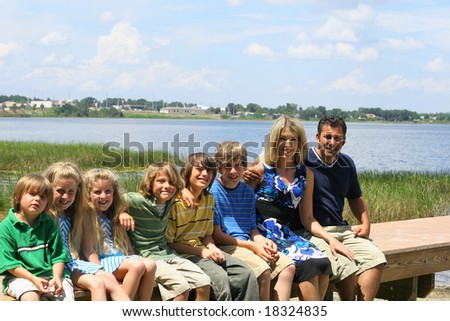 beautiful family on the dock - stock photo