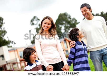Beautiful family taking a walk and looking happy - stock photo