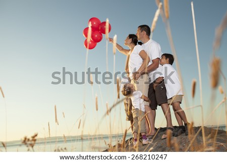 beautiful family who have fun in the ocean border - stock photo
