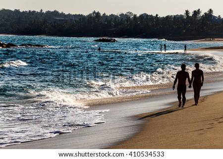 Beautiful fantastic sunset on beach landscapes. Selective focus. - stock photo