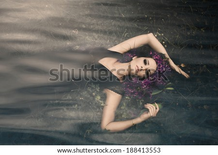 beautiful fantasy water nymph composite photo - stock photo