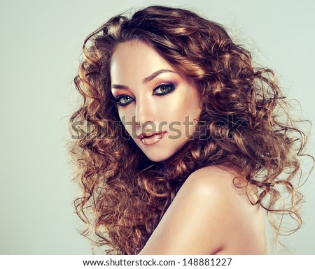 Beautiful fashion girl with curly hair - stock photo