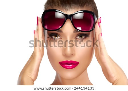 Beautiful fashion model girl holding her shades on forehead while looking at camera. Bright makeup and manicure. High fashion portrait isolated on white background. Beauty and fashion concept. - stock photo