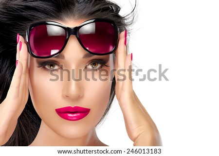 Beautiful fashion model girl with healthy long hair in motion holding her shades on forehead while looking at camera. Isolated on white background with copy space for text. Beauty and fashion concept. - stock photo