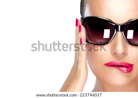 Beautiful fashion model girl with stylish oversized black sunglasses. Bright makeup and manicure. High fashion portrait isolated on white with copy space for text. Beauty and fashion concept. - stock photo