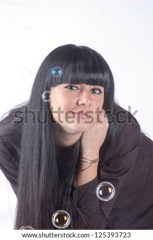 Beautiful fashion model in studio and soap bubbles - stock photo