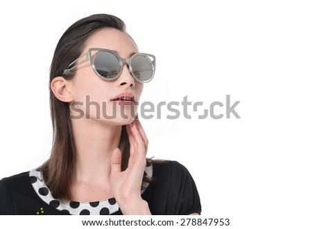 Beautiful fashion model in sunglasses posing - stock photo