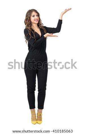 Beautiful fashion model presenter showing hand on copyspace with open palms. Full body length portrait isolated over white studio background. - stock photo