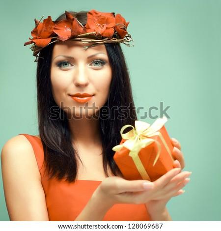 Beautiful fashion model with gift - stock photo