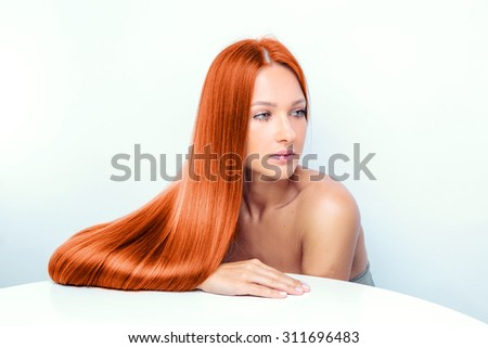 beautiful fashion model with long red hair. - stock photo