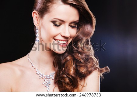 beautiful fashion model with perfect makeup wearing jewelry - stock photo