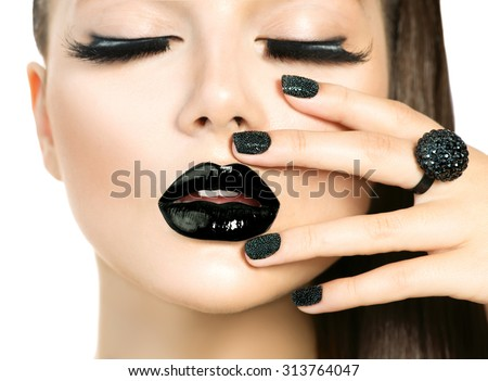 Beautiful Fashion Model woman with Long Lashes and Black make up isolated on white. Fashion Trendy Caviar Black Manicure. Nail Art. Dark Lipstick and Nail Polish. Vogue style - stock photo
