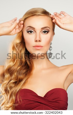 Beautiful Fashion Model. Woman with Makeup and Blond Wavy Hairstyle - stock photo