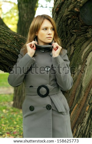 Beautiful fashion woman in fashionable season coat - stock photo