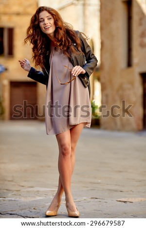 Beautiful fashion woman outdoor on the street of the old Italy town - stock photo