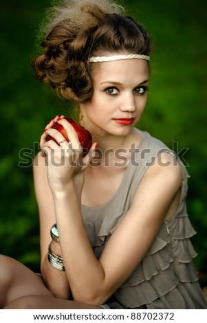 beautiful fashion woman with apple in hand - stock photo