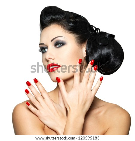 Beautiful fashion woman with red lips, nails and creative hairstyle - isolated on white background - stock photo