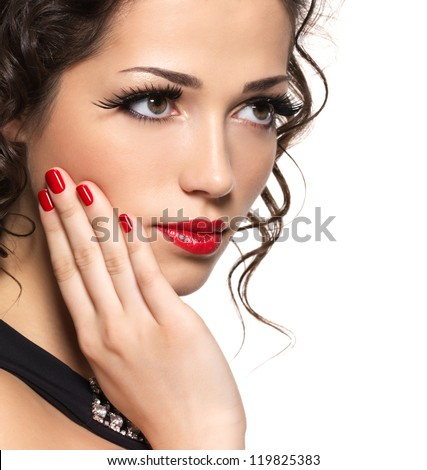 Beautiful fashion woman with red manicure and lips - isolated on white background - stock photo