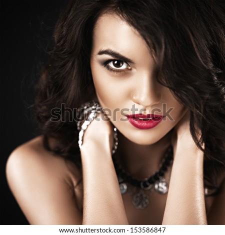Beautiful fashionable Brunette Girl. Perfect Makeup. Make-up. Close-up Portrait - stock photo