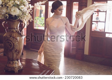 Beautiful fashionable girl in retro interior. Diamond Dress . - stock photo
