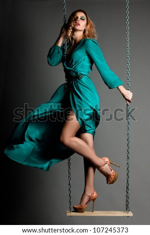 beautiful fashionable woman in blue dress - stock photo