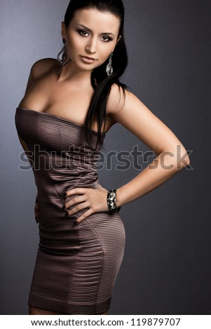 beautiful fashionable woman in brown dress - stock photo