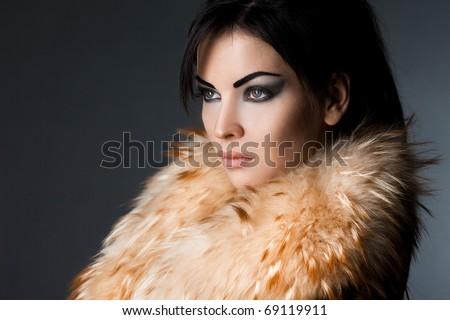 beautiful fashionable woman in fur coat - stock photo