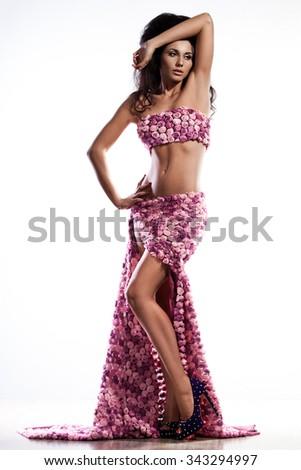 beautiful fashionable woman in pink dress - stock photo